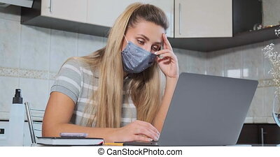 depressed long haired freelancer in blue disposable mask - ...