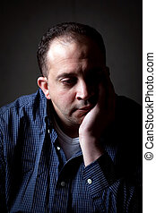 Depressed Man - A middle aged man with a contemplative look ...