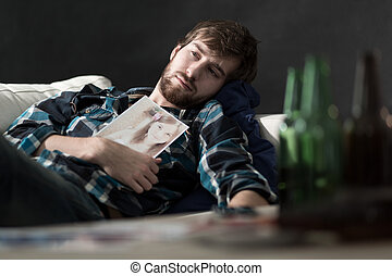 Depressed man after split up - Depressed man drinking beers...
