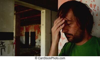 Depressed man in ruined interior