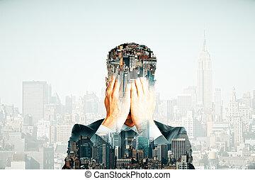 Depressed man on city background