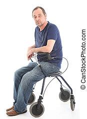 Depressed man sitting on medical walker