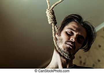 Depressed man with a noose around his neck.