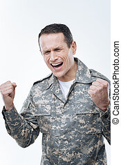 Depressed military man showing his emotions