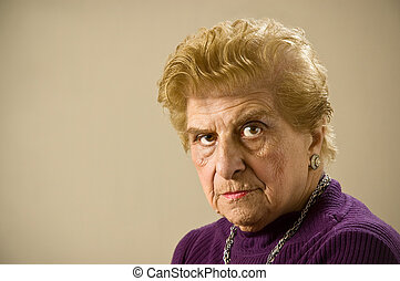 Depressed old woman. - Depressed old woman staring at the...