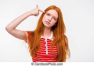 Depressed redhead young woman with finger to temple like gun