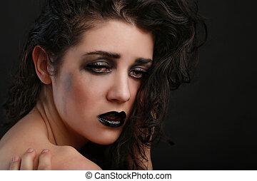 Depressed Sad Thinking Woman on Black Background