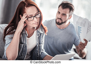 Depressed sad woman holding her forehead