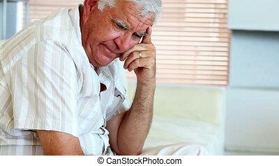 Depressed senior man sitting on the