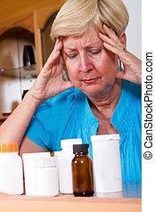 depressed senior woman with medicine or health problem
