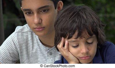 Depressed Teen Hispanic Brothers