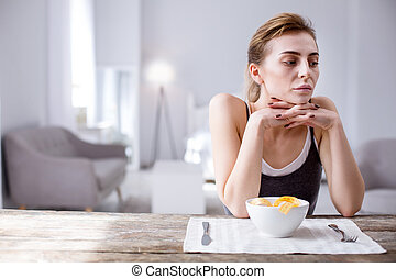 Depressed thoughtful woman thinking about her weight