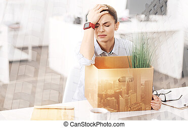 Depressed unemployed woman sitting in the office