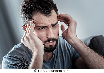Depressed unhappy man having a headache