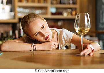 Depressed unhappy woman lying on the table