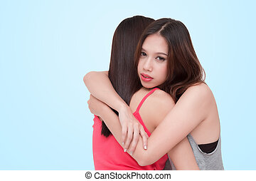 Depressed woman embracing her friend.