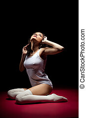 depressed woman in white look at light with hope