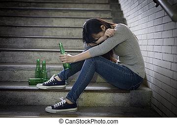depressed woman sit in underground