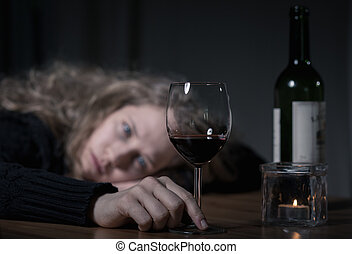 Depressed woman with wine