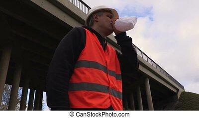 Depressed worker breaths in paper bag