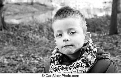 Depressed young boy looking directly ahead