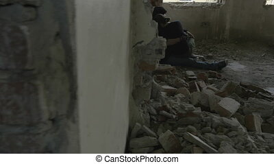 Depressed young couple sitting in an abandoned building