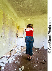 depressed young girl in old house interior