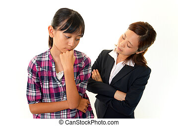 Depressed young girl with teacher