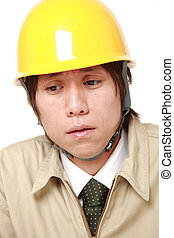 depressed young Japanese construction worker