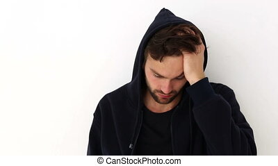 Depressed young man on white background