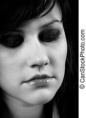 Depressed young woman in black and white