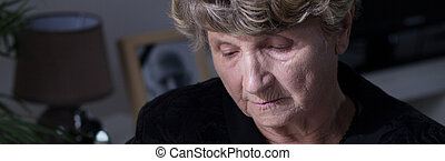 Depression after death - Old woman is depressed after...