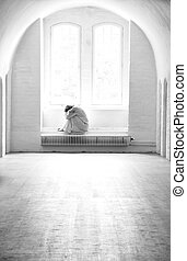 Depressed woman lonely in a mental institution.