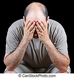 Devastated man worrying about hair loss problem