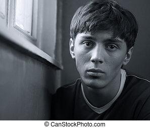 Depression - Portrait of a young man feeling bad. b/w+blue...