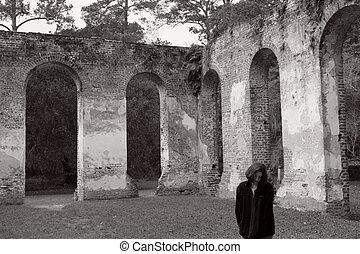 Depression - Sad woman in a ruin, black and white