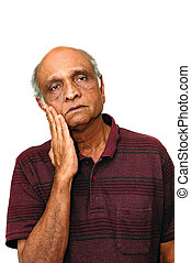 Depression - An old Indian immigration looking sad with a...