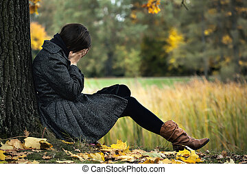Depression - Young woman having autumn depression and crying