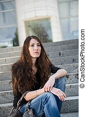 Depression - young woman outdoor portrait