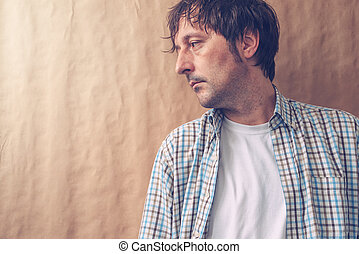 Depressive sad man profile portrait