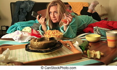 Depressive woman eating and waching