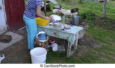 deprived woman wash dish