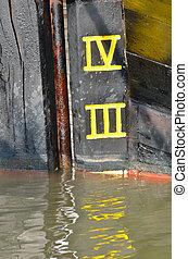 Depth Marker Detail on Wooden Boat