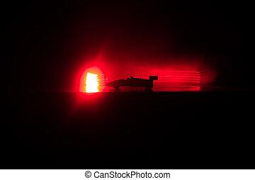 der, auto, in, der, schatten, mit, glühen, lichter, in,...