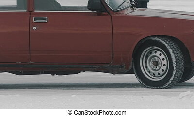 Derby car Drifting winter snow from under the wheels. Slow...