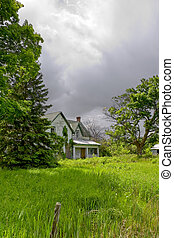 Derelict House Under Stormy Skies