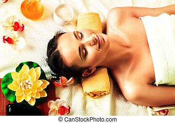 derive pleasure - Beautiful young woman taking spa...