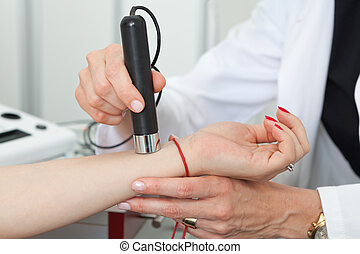 Dermatologist examining birthmarks and moles on a female patient
