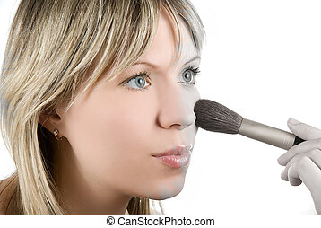 Desaturation - Girl with brush painting her face on white