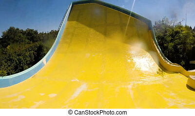 descending down on water slide in water park, first person...